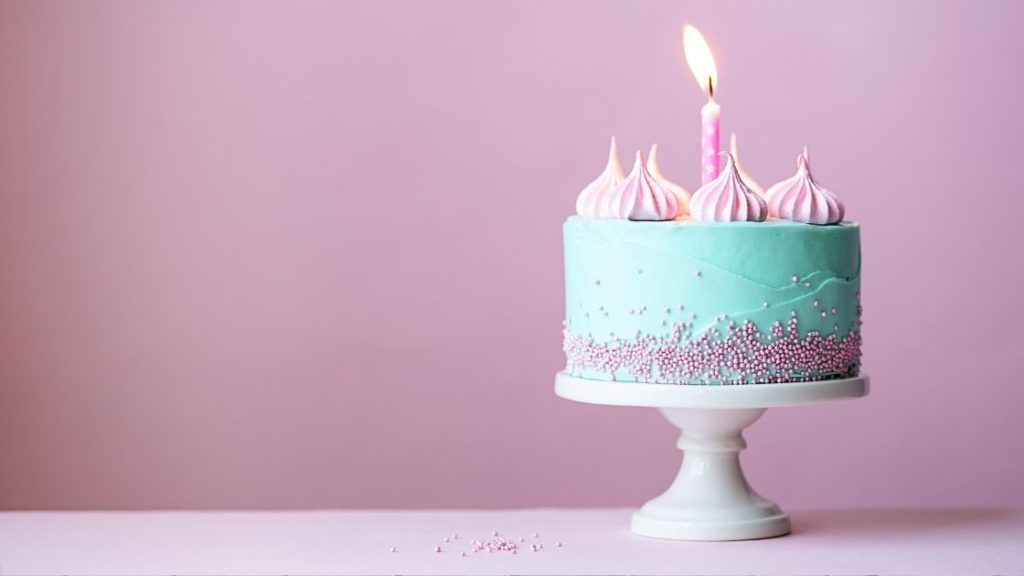 Birthday cake with pink background